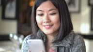 Asian woman, phone message. video