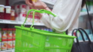 Asian woman shopping in supermarket,Close-up video