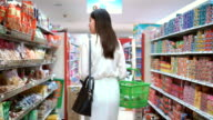 Asian woman shopping in supermarket,Slow motion video