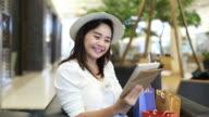 Asian woman shopping online video