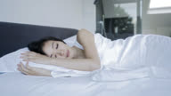 Asian woman sleeping comfortable at home video