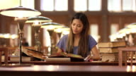 DS Asian woman studying in library's reading room video