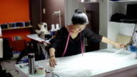 Asian woman tailor fashion clothes dress designer working with fabric video