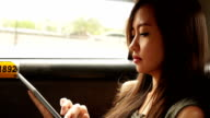 Asian woman using digital tablet video