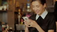 Asian woman using smartphone video