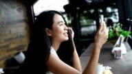 Asian woman using video conference in smart phone video