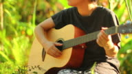 Asian woman with guitar video