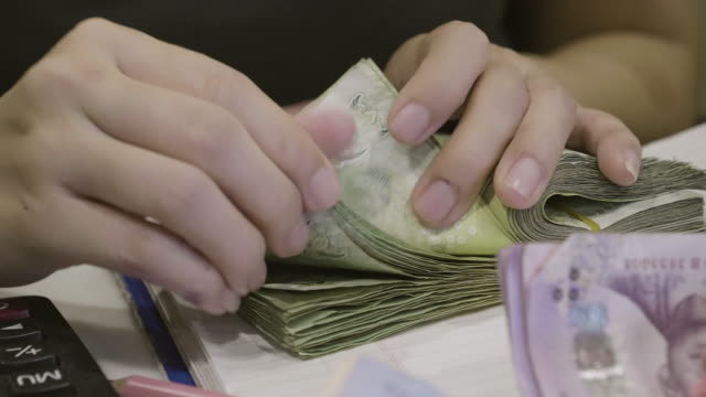 Asian Women Counting Money Thai Baht On Her Workplace In Home video