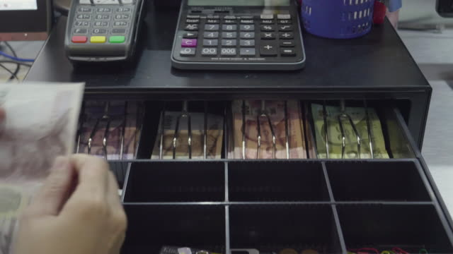 Asian Women Dispensing Change And Counting From A Register Cash Drawer video
