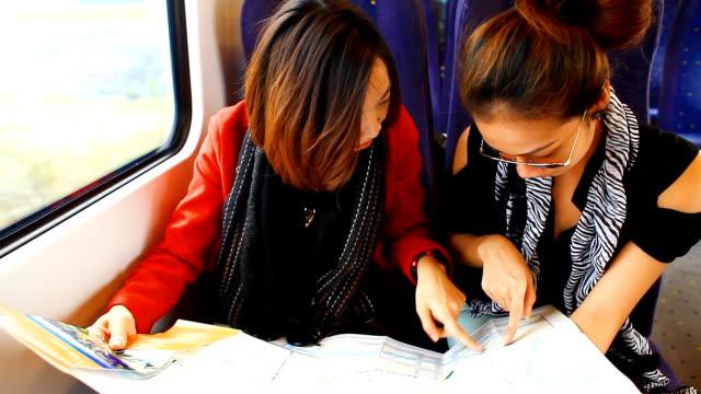 HD:2 Asian women looking the map. video