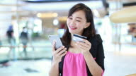 Asian women shopping online video