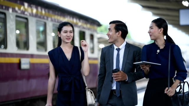 asian young group business talk on workplace in environment train station video