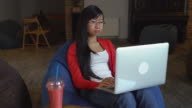 Asian young professional woman working on computer drinking a smoothies video