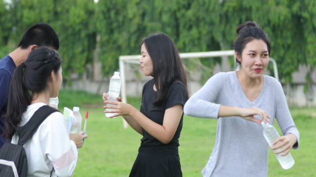 Asian Young woman drinking water video
