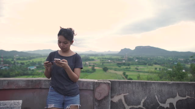 Asian young woman pay credit card and typing on phone. video