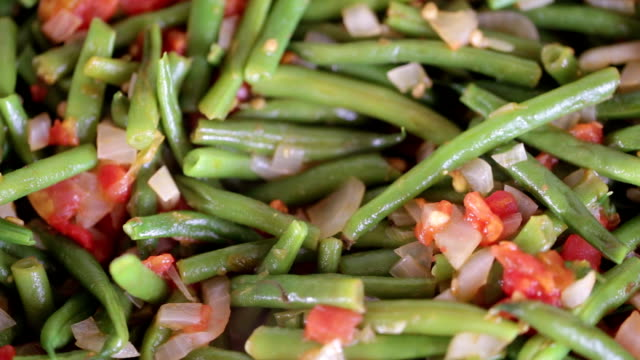 Asparagus beans are fried in a frying pan video