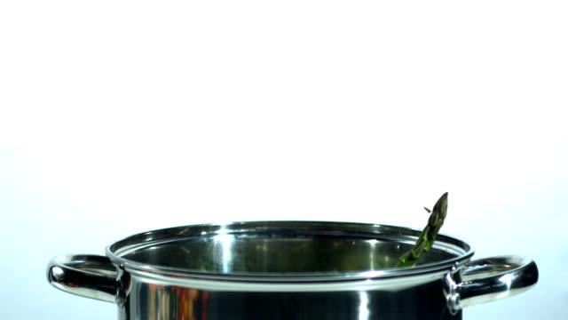 Asparagus falling into a saucepan video