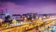 Asphalt road and modern skyline cityscape at night, Kunming China video