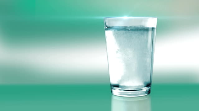 Aspirin in a water glass-green video