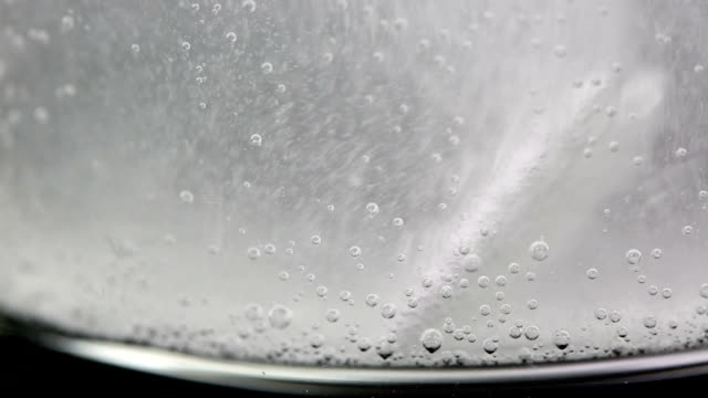 Aspirin in glass of water video