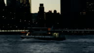 Рassenger boat moving forward. Night New York cityscape on background video