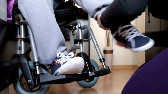 Assistance for a disabled man in wheelchair video