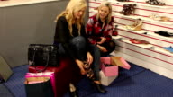 Assistant helping Customer in shoe shop - Wide video