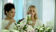 Assisting a Customer in Flower Shop video