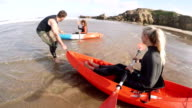 Assisting Women in their Kayaks out to Sea video