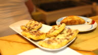 Assorted quiches served on a plate in a restaurant video