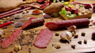 Assortment of Meat products on a wooden board. video