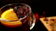 Asterisk anise falls from above in a nice mug of mulled wine video