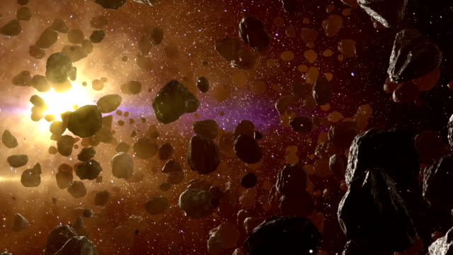 Asteroid field in outer space against sun video