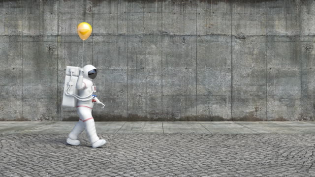 Astronaut Walking On A City Sidewalk Holding A Balloon video