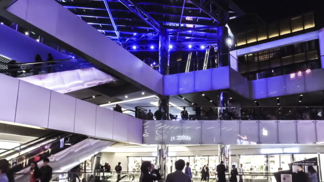 At evening,the fashion young people wander at the Sanlitun Village shopping square, Beijing, China video