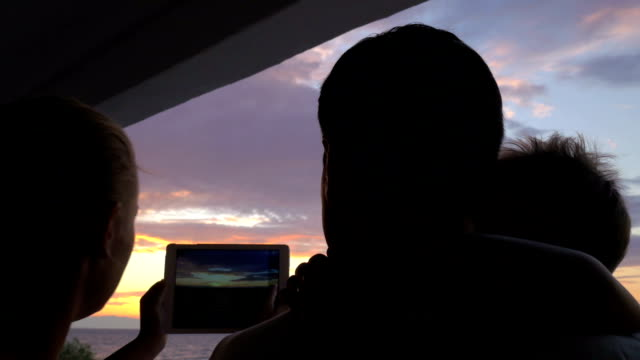 At sunset family photographed on tablet in city Perea, Greece video