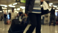 At the airport - people with luggage video