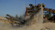 At the plant at high conveyor moves the sand and drops down video