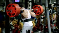 athlete powerlifter sets in the gym a new record one in two hundred pounds kilogram of the dangerous end of the exercise, the bar barely enters into the slots on the rack video