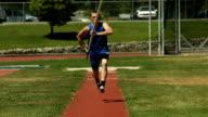 Athlete running in pole vault, super slow motion video