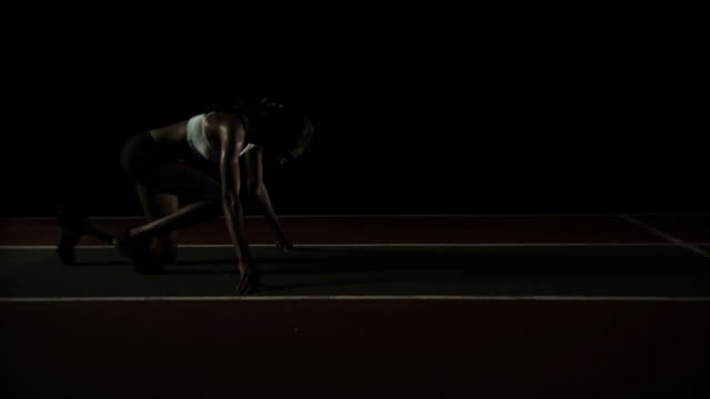 Athlete sprints on a track. video
