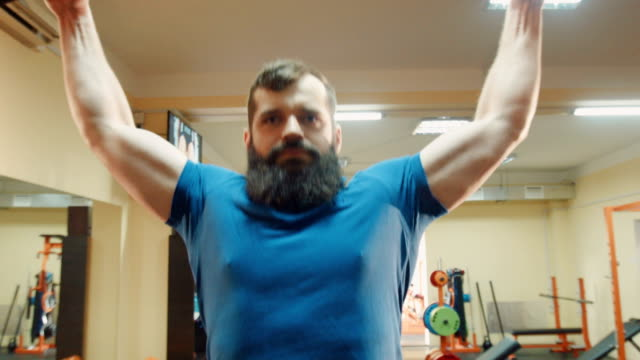 Athlete with beard does pulling up video