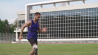 Athlete with prosthetic leg speed walking in slow motion video