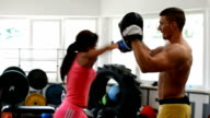 Athlete woman and fitness instructor on boxing training video