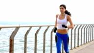 Athlete woman running on pier video