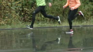 Athletes Running on Wet Path video