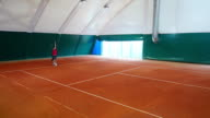 Athletes train hit while jumping on the tennis court video