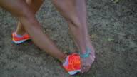 Athletic blonde woman stretching before running on dirt path video