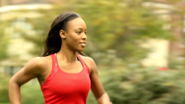 Athletic Female Runs from Left to Right - CU video