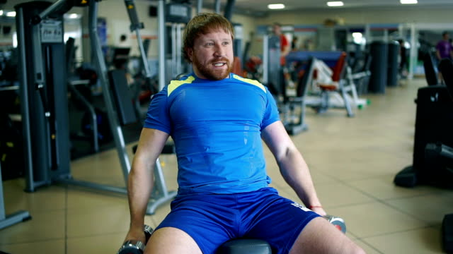 Athletic man doing exercises in a gym video